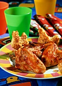 Chicken wings & peanut butter sandwiches on child's plate