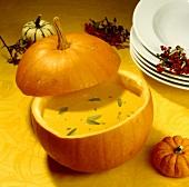 Pumpkin soup with sage, served in pumpkin