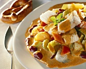 Fish stew with celery and red beans