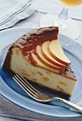 A piece of peach cheesecake