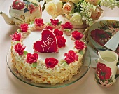 White Mother's Day cake with red marzipan rose