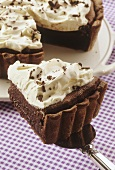 Mississippi chocolate cream tart with whipped cream