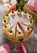 A raspberry cream gateau with cream rosettes & mint leaves