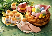 Bread Easter basket and sponge cake in egg shells