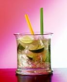 A glass of Caipirinha with two straws