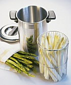 White asparagus in sieve, asparagus pan & green asparagus