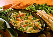 Asparagus and vegetable gratin with ham