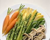 Plate of blanched vegetables: carrots, asparagus, mushrooms etc
