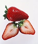 A whole and a cut strawberry