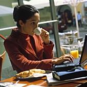 Woman Drinking Espresso at Breakfast