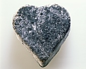 A heart-shaped goat's cheese in ash