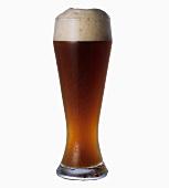 Ein Glas Weissbier mit Schaumkrone