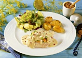 Cod fillet with mustard & pepper sauce, potatoes & salad