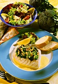 Nile perch fillet with broccoli and lemon & wine sauce