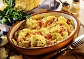 Potato and cauliflower gratin with strips of ham