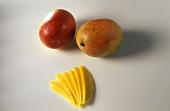 Whole mangoes and mango fan