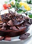 Chocolate gateau with chocolate leaves
