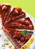 Red berry tart with cherries and berries