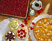 Morello cherry tart, peach tart & tartlets with berries