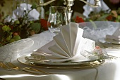 Festive table setting for one person with decorative napkin
