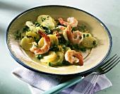 Potato salad with peas, chervil and jumbo prawns