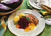 Duck breast with red cabbage and oranges