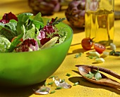Mixed salad leaves in green dish