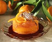 Orange tartlet with grapefruit on red fruit sauce