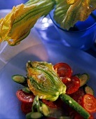Courgette & tomato salad with stuffed courgette flowers