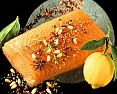 Salmon fillet with spices, a lemon beside it