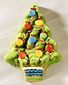 Baked fir tree with colourful baubles & tinsel