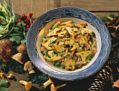 Pasta salad with mushrooms, décor: pine cones & mushrooms