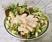 Mixed salad with turkey breast fillet and pineapple
