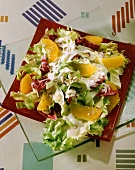 Mixed salad with sunflower seeds and orange segments