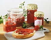 Strawberry and rhubarb preserve in jars and on roll