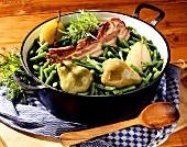 Pears, green beans and bacon in pot