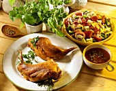 Rabbit legs, with mixed salad and peppered cream sauce