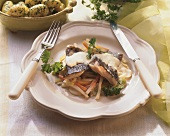Carp on bed of vegetables with parsley potatoes