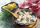 Cod with dill sauce and potatoes