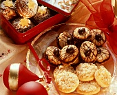 Assorted Christmas biscuits on plate and in tin