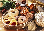 Various Christmas biscuits in silver bowl