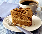 A piece of walnut cake, with coffee