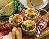 Mince and savoy pie with mashed potato & cheese topping