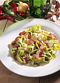 Finocchiona (salami salad with green ribbon pasta, Italy)