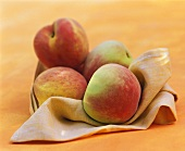 Peaches Bundled in a Napkin
