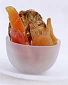 Various dried fruits in white bowls