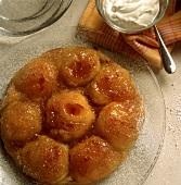 Apple tart, bowl of crème fraiche beside it