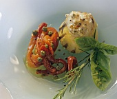 Polenta tower with peppers as accompaniment or snack