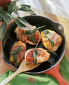 Turkey escalope wrapped in bacon with sage & peppers