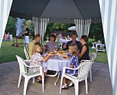 Family eating in restaurant garden